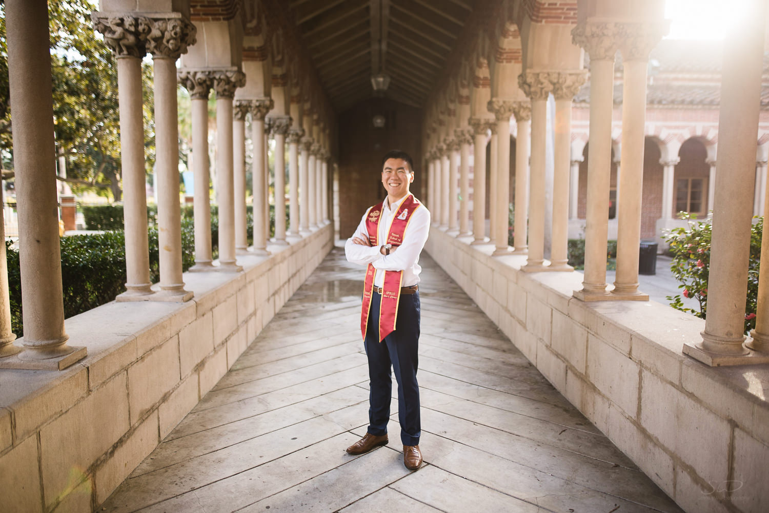 USC college senior graduate standing in iconic hallway by Stanley Wu Photography | Los Angeles Portrait & Wedding Photographer
