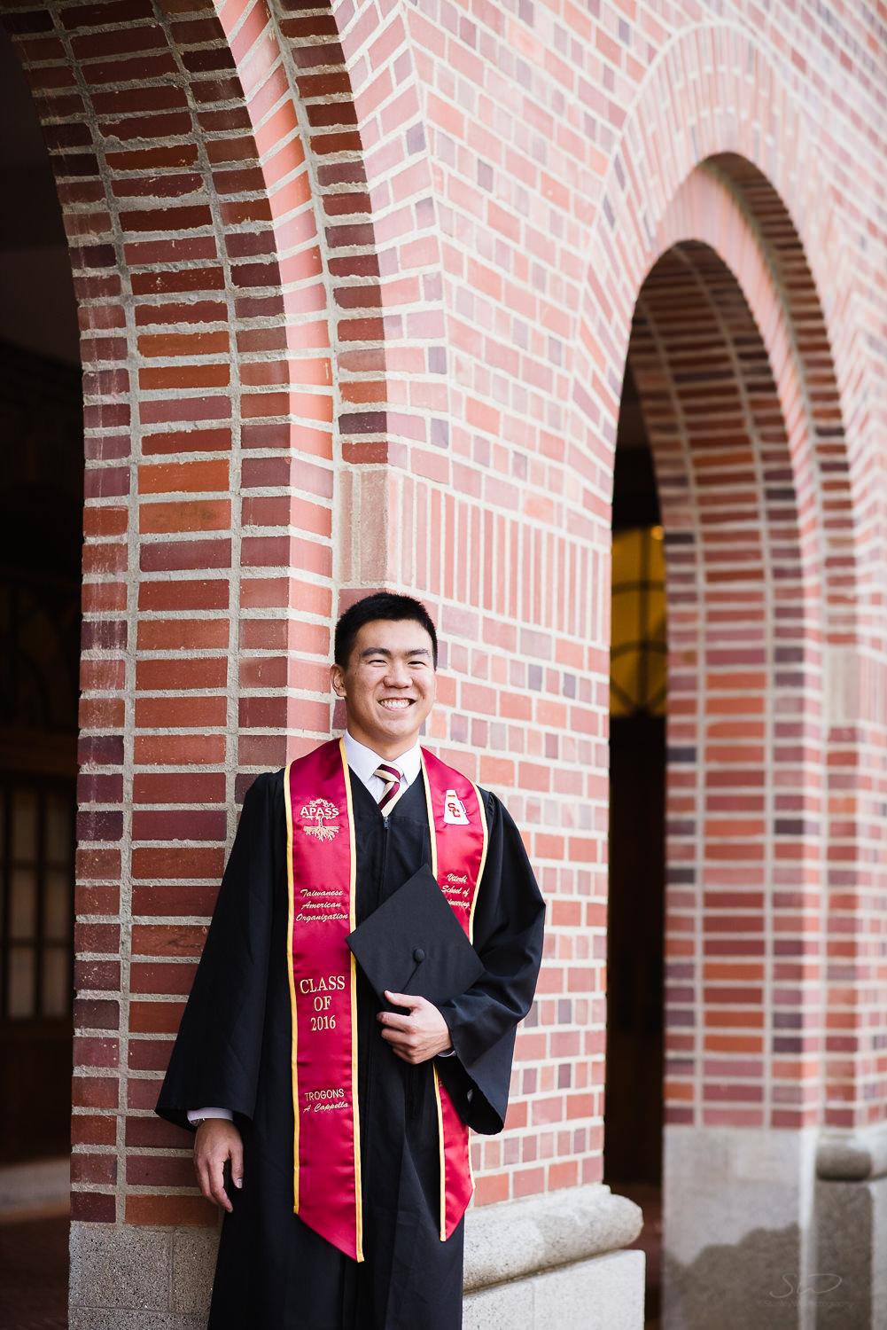 USC college senior graduate in cap and gown by Stanley Wu Photography | Portrait & Wedding Photographer serving Los Angeles, Orange County, and Southern California