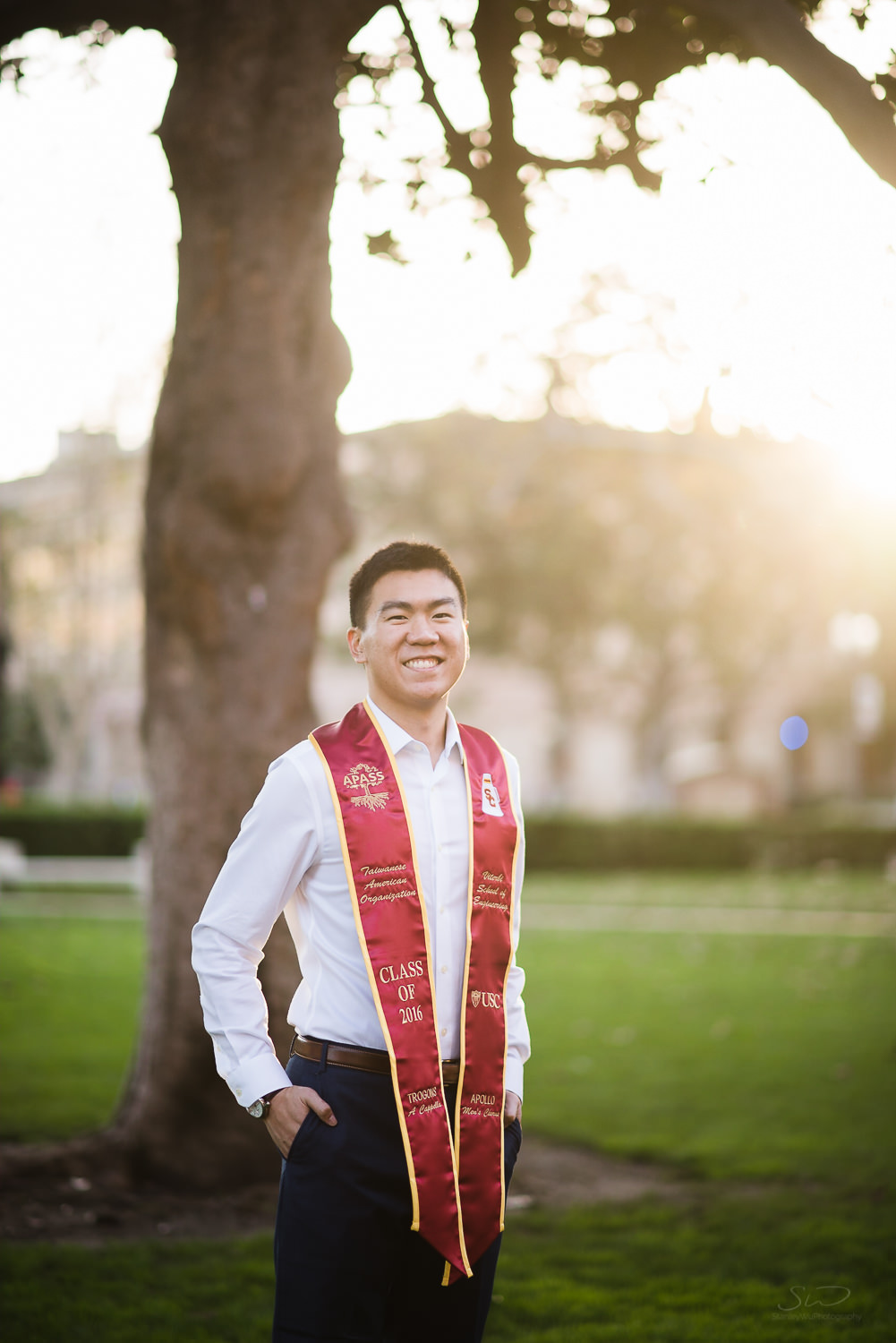 Portrait of USC college senior graduate backlit by golden sun by Stanley Wu Photography | Portrait & Wedding Photographer serving Los Angeles, Orange County, and Southern California