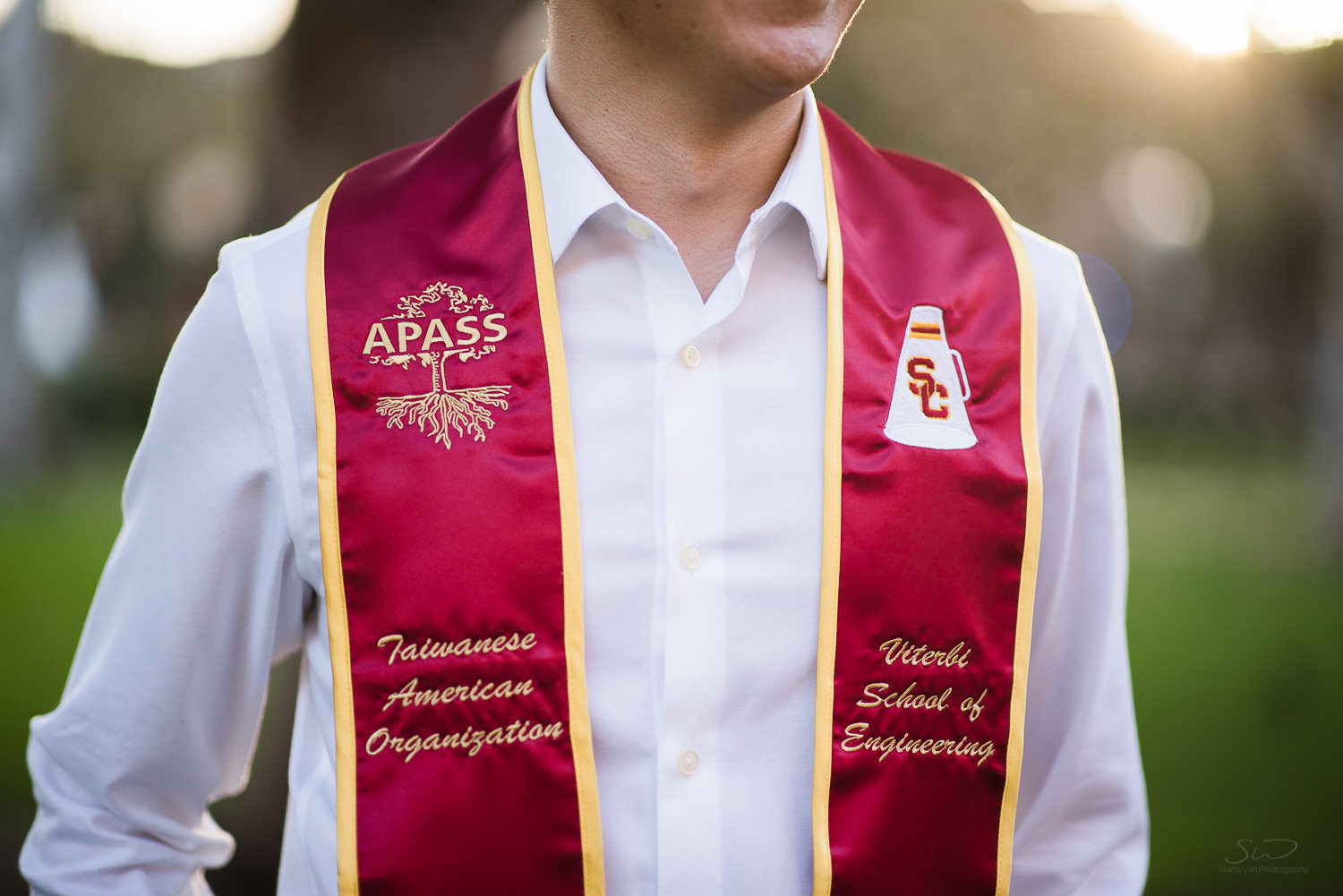 Detail shot of USC college senior graduate's sash by Stanley Wu Photography | Portrait & Wedding Photographer serving Los Angeles, Orange County, and Southern California