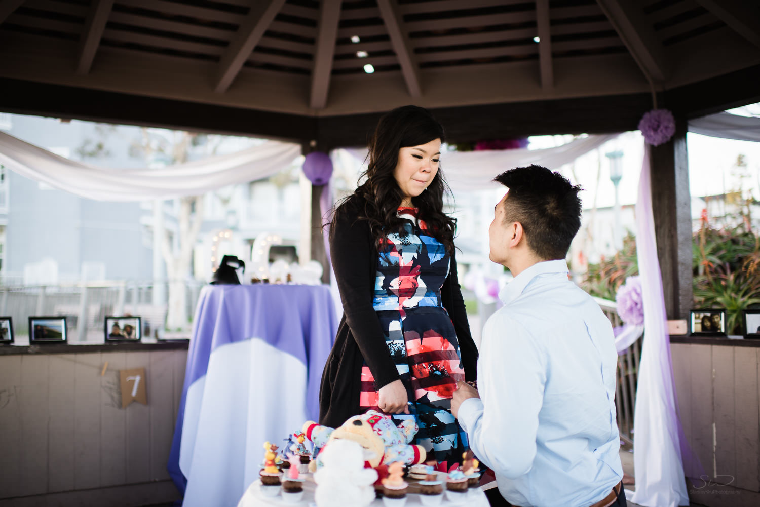 Kneeling down. Cliffside proposal & engagement in Dana Point | Stanley Wu Photography Portrait & Wedding Photographer | Los Angeles, Orange County, Southern California