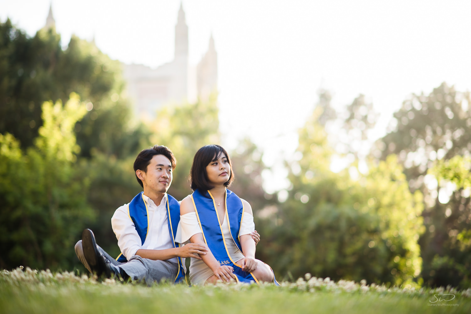 Copy of Copy of college senior couple posing together on grass wearing 2017 sashes  | Stanley Wu Photography | Los Angeles | Graduation Portraits | UCLA, USC, LMU, Pepperdine, CSULA, CSUN, CSULB, UCI, UCSD