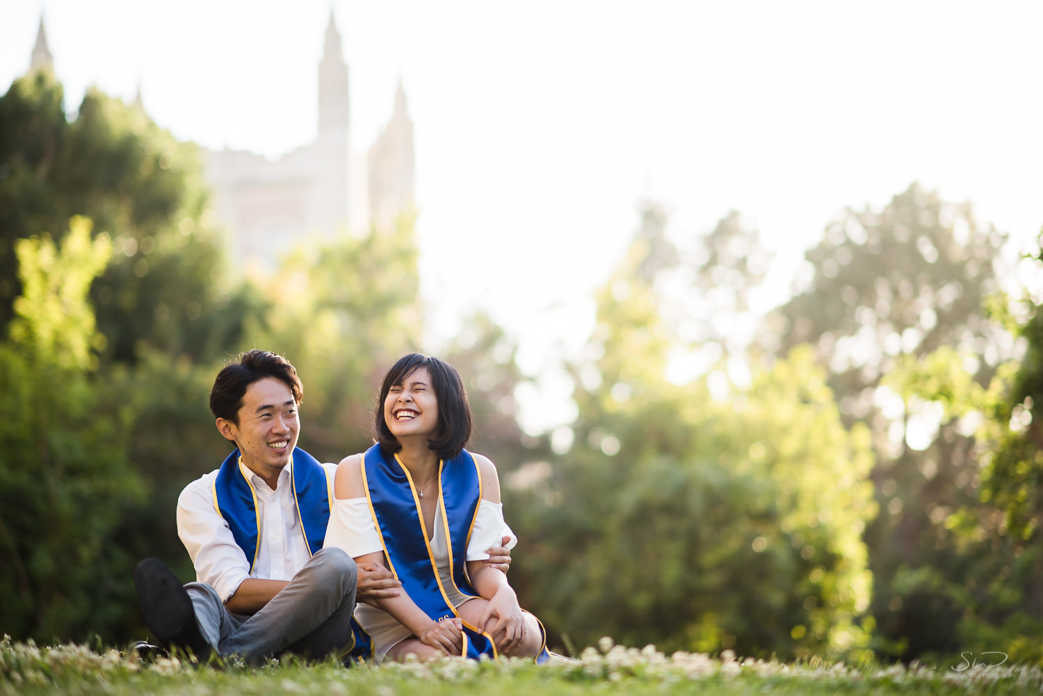 Copy of Copy of college senior couple posing together and laughing wearing 2017 sashes  | Stanley Wu Photography | Los Angeles | Graduation Portraits | UCLA, USC, LMU, Pepperdine, CSULA, CSUN, CSULB, UCI, UCSD