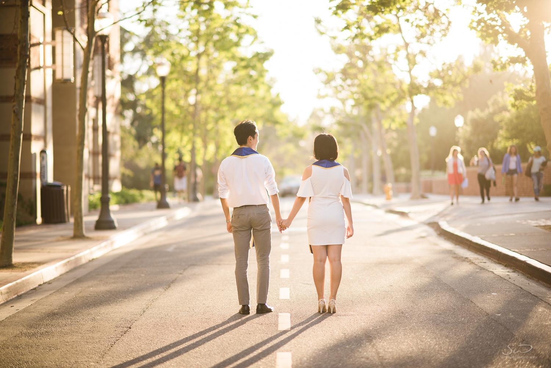 Copy of Copy of college senior couple walking towards the sunset | Stanley Wu Photography | Los Angeles | Graduation Portraits | UCLA, USC, LMU, Pepperdine, CSULA, CSUN, CSULB, UCI, UCSD