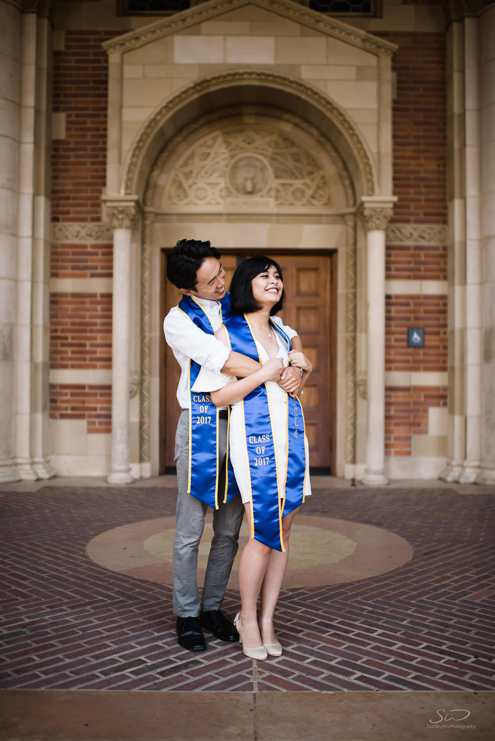 Copy of Copy of couple hugging under arches in royce hall  | Stanley Wu Photography | Los Angeles | Graduation Portraits | UCLA, USC, LMU, Pepperdine, CSULA, CSUN, CSULB, UCI, UCSD