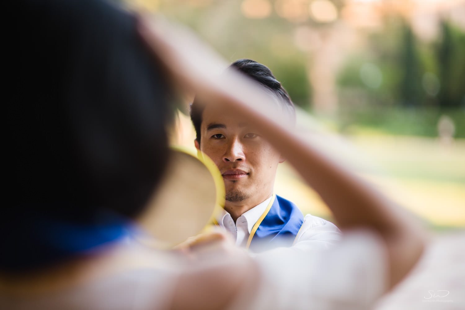 Copy of Copy of behind the scenes makeup with boyfriend holding mirror  | Stanley Wu Photography | Los Angeles | Graduation Portraits | UCLA, USC, LMU, Pepperdine, CSULA, CSUN, CSULB, UCI, UCSD