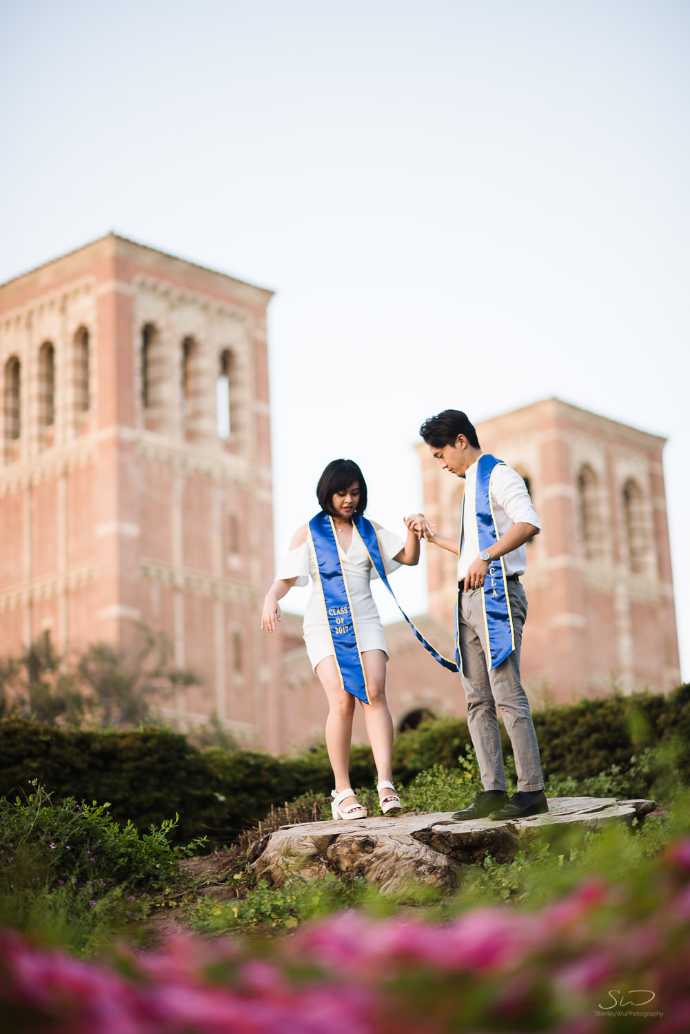 Copy of Copy of couple getting ready for a photo on a tree stump  | Stanley Wu Photography | Los Angeles | Graduation Portraits | UCLA, USC, LMU, Pepperdine, CSULA, CSUN, CSULB, UCI, UCSD