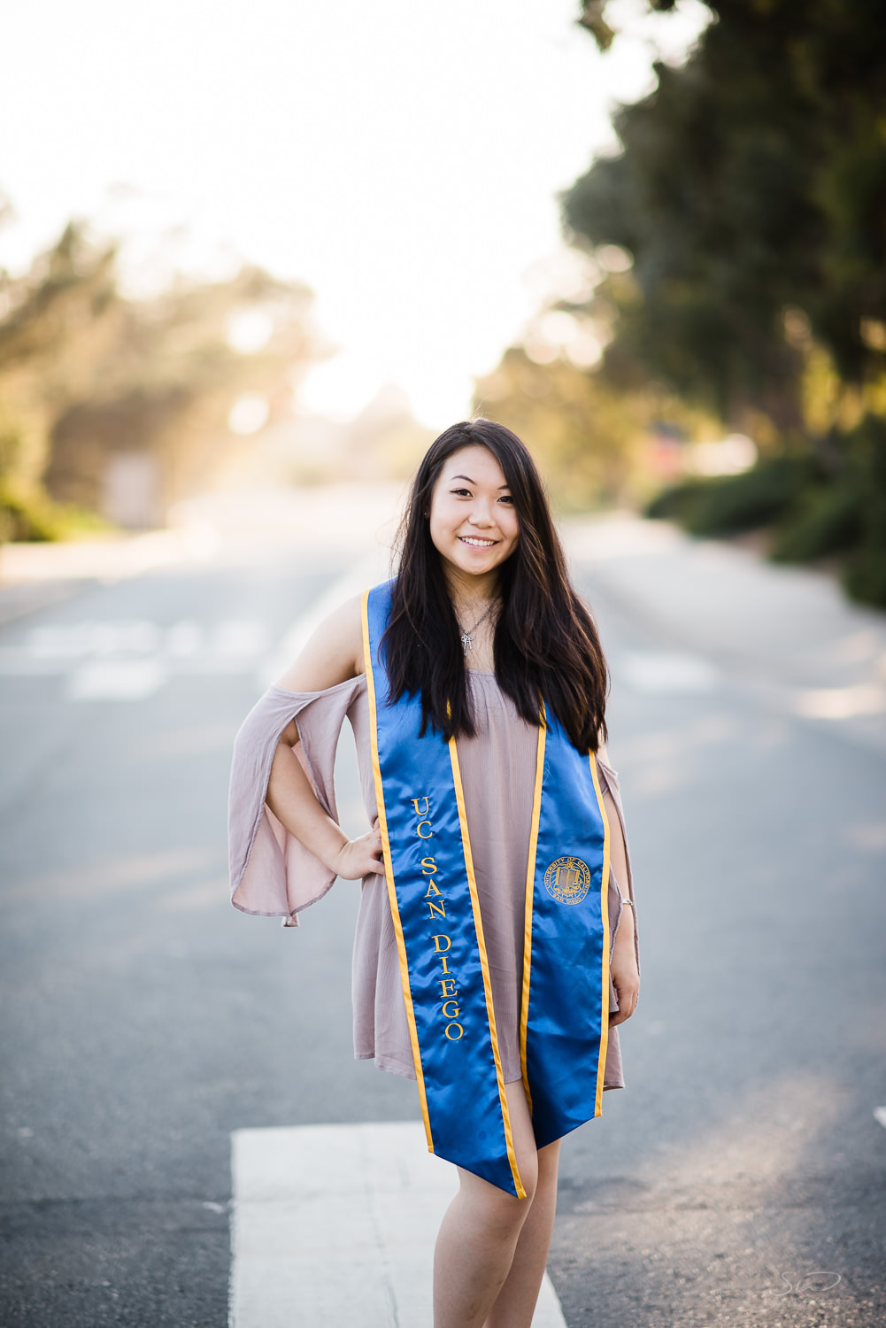 Posing on campus. Best graduation portrait photography, San Diego.