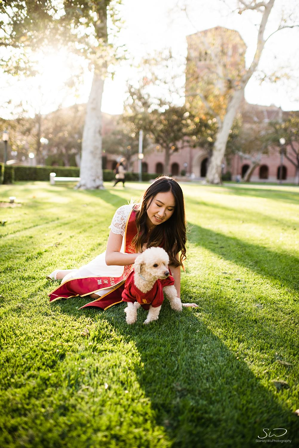 Playing with poodles at USC | Los Angeles Orange County Senior Portrait & Wedding Photographer