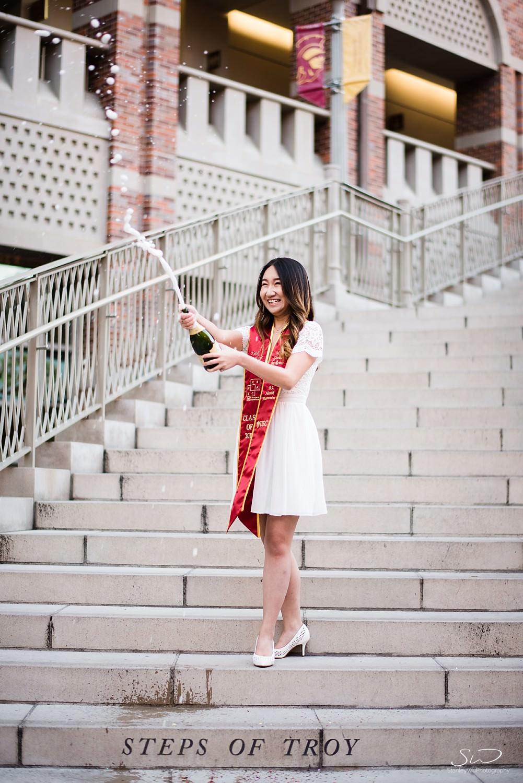 Champagne pop graduation photo at USC | Los Angeles Orange County Senior Portrait & Wedding Photographer