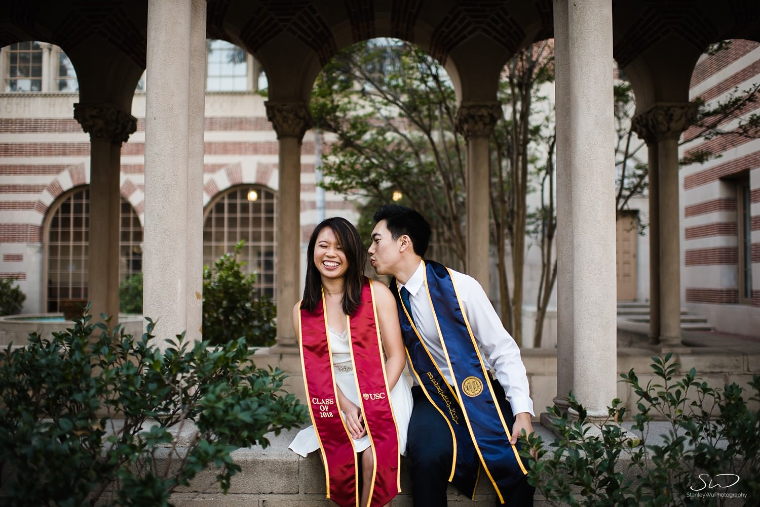 UC Berkeley and USC couple sitting at Mudd Hall | Los Angeles Graduation and Senior Portrait Photographer