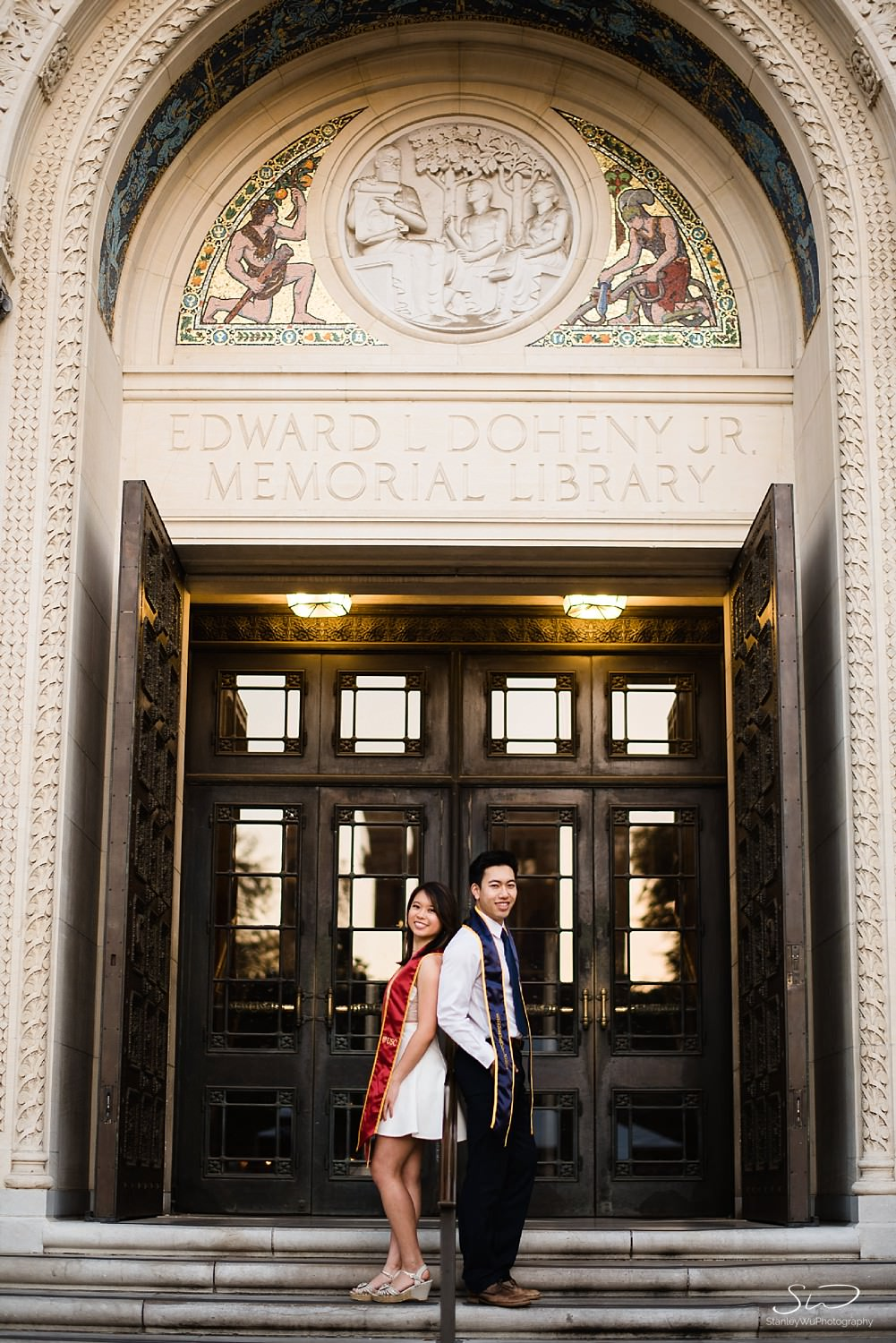 USC and UC Berkeley couple standing together at Doheny Library USC | Los Angeles Graduation and Senior Portrait Photographer