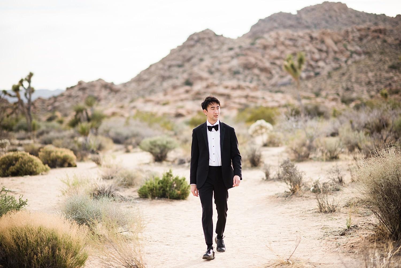 Groom walking in the desert | Joshua Tree Desert Wedding & Engagement Inspiration