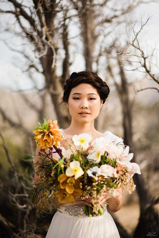 Bride with desert flower bouquet | Joshua Tree Desert Wedding & Engagement Inspiration