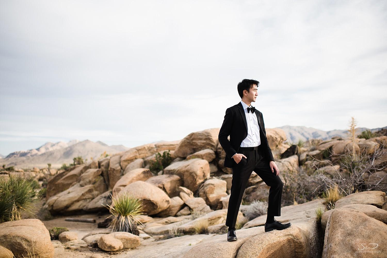 Groom posing on the rocks | Joshua Tree Desert Wedding, Engagement, Elopement Inspiration