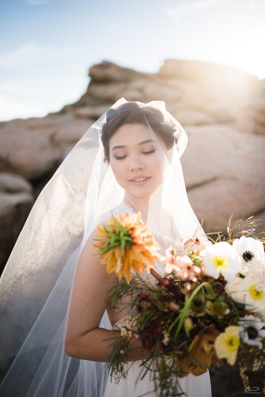 Beautiful sunlight streaming through bridal veil and wedding bouquet | Joshua Tree Desert Wedding, Engagement, Elopement Inspiration