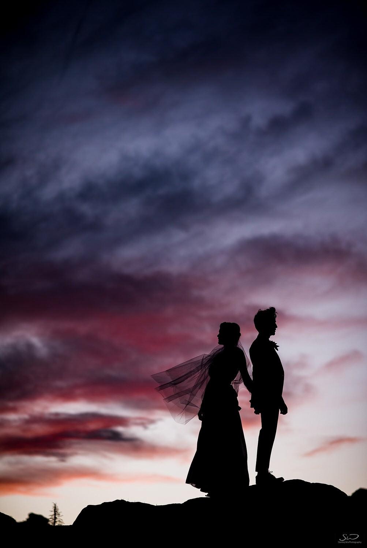 Epic sunset silhouette with couple | Joshua Tree Desert Wedding, Engagement, Elopement, Adventure Inspiration