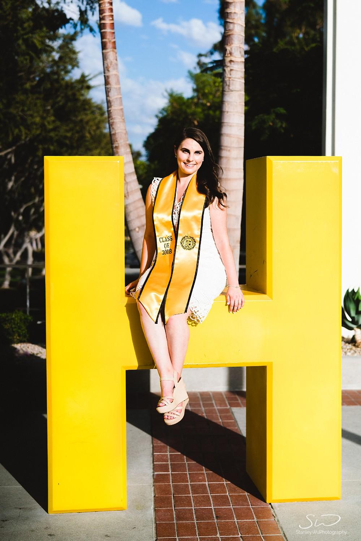 girl sitting on go beach graduation senior photos portraits at csulb