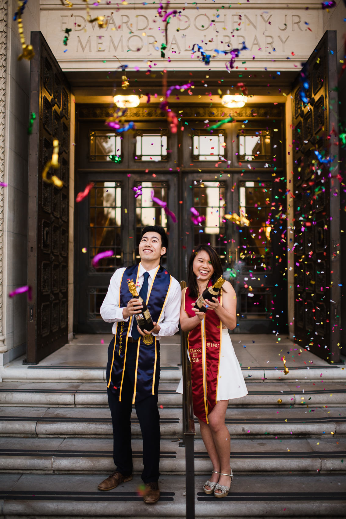 a couple celebrating their graduation with confetti poppers at usc and uc berkeley