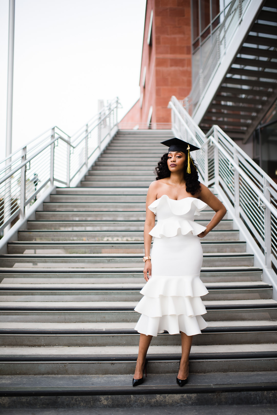 dramatic fashionable pose of a graduate at csu los angeles