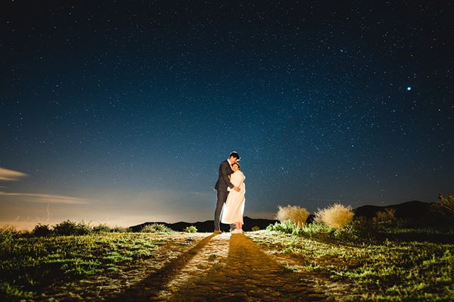 Without you, all the shine of a thousand spotlights, all the stars we steal from the night sky will never be enough #guesswhichsong⁠ ⁠ Such a beautiful Joshua Tree wedding with @zhoutopia and @noaheatscheese!⁠ ⁠ Photographer: @stanleywuphotography⁠ Venue: @rimrockranch⁠ Coordinator: @eventsbyabel⁠ Videographer: @wanderlandmediaa⁠ Bridal Bouquet: @landmarkplantco⁠ DJ: @chasingabe⁠ Hair & Makeup: @jenpluscolour⁠ ⁠ -⁠ -⁠ -⁠ -⁠ #joshuatreewedding #joshuatreeelopement #joshuatreeengagement #joshuatree #desertwedding #wedding #desert #astrophotography #milkyway #astroportrait #losangelesweddingphotographer #ocweddingphotographer #losangelesengagementphotographer #weddingphotography #justengaged #justmarried #weddinginspiration #engagementinspiration #engagementphotography #adventuresession #couplesphotography #theknot #weddingwire