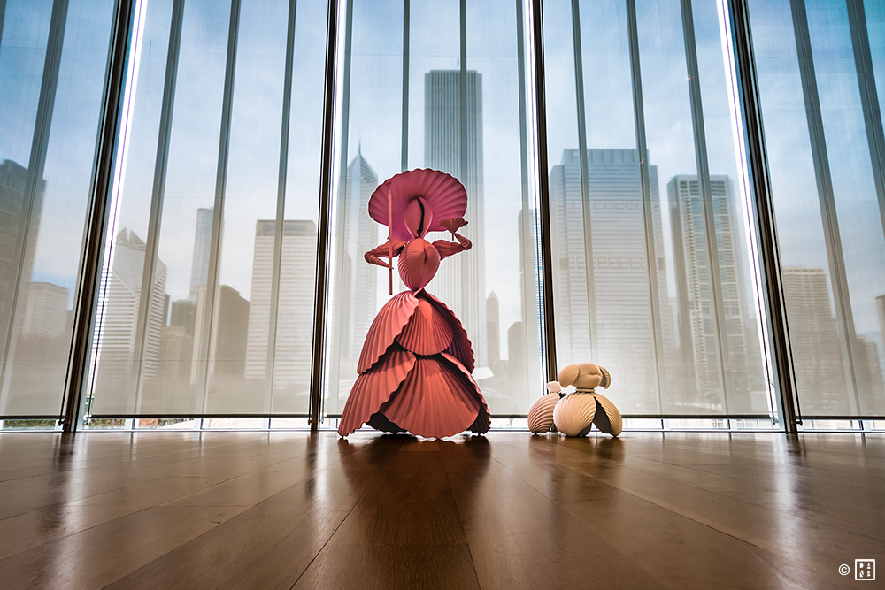 """Pictured: """"Woman with Dog"""" sculpture (Katharina Fritsche, 2004) on display at the Art Institute of Chicago; the piece, made up of polyester, wood and paint, is edition two of just three.Photo Credit: Dan Bretz"""