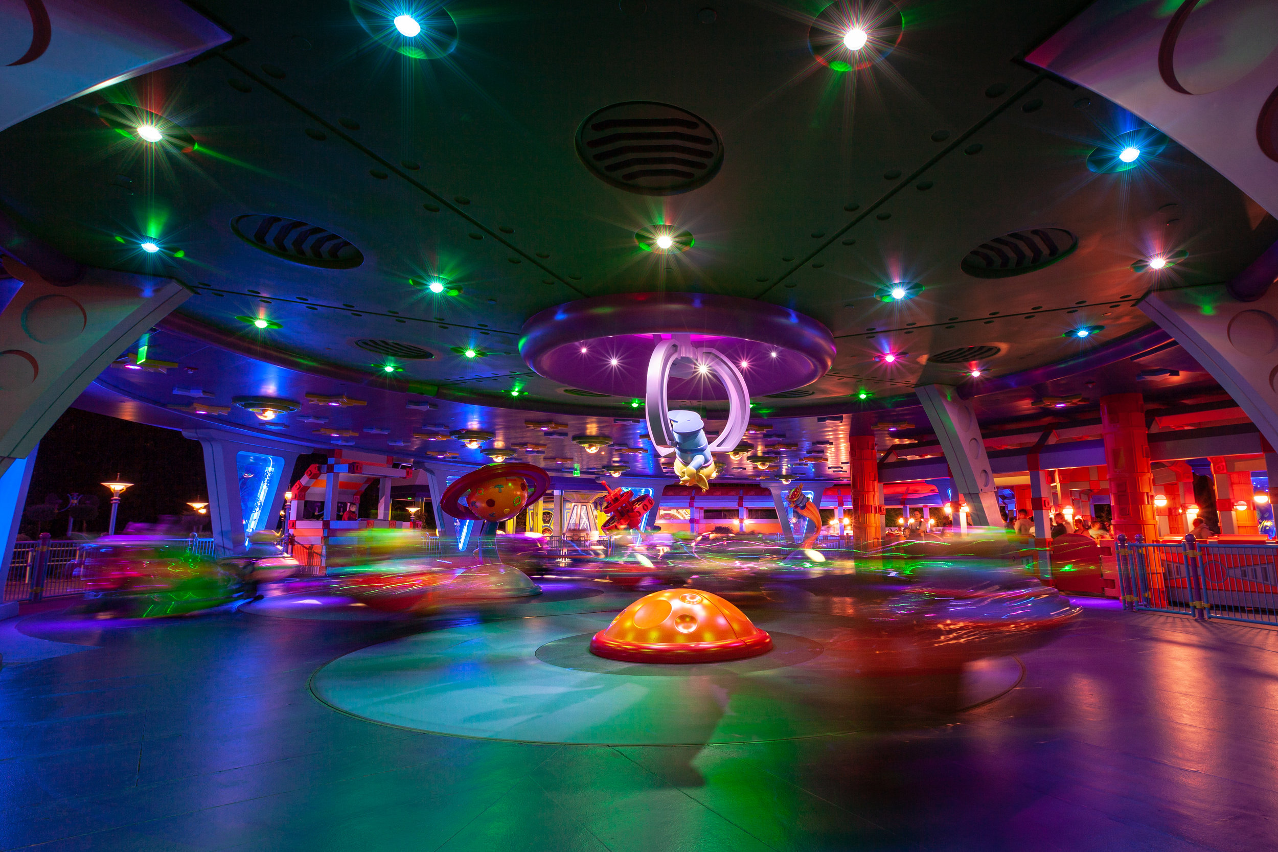 Alien Swirling Saucers at Toy Story Land. Shot with: Canon 5D Mark II, 16-35mm 2.8 II lens at 16mm. Exposure 2.0 sec at f/10, ISO 100.