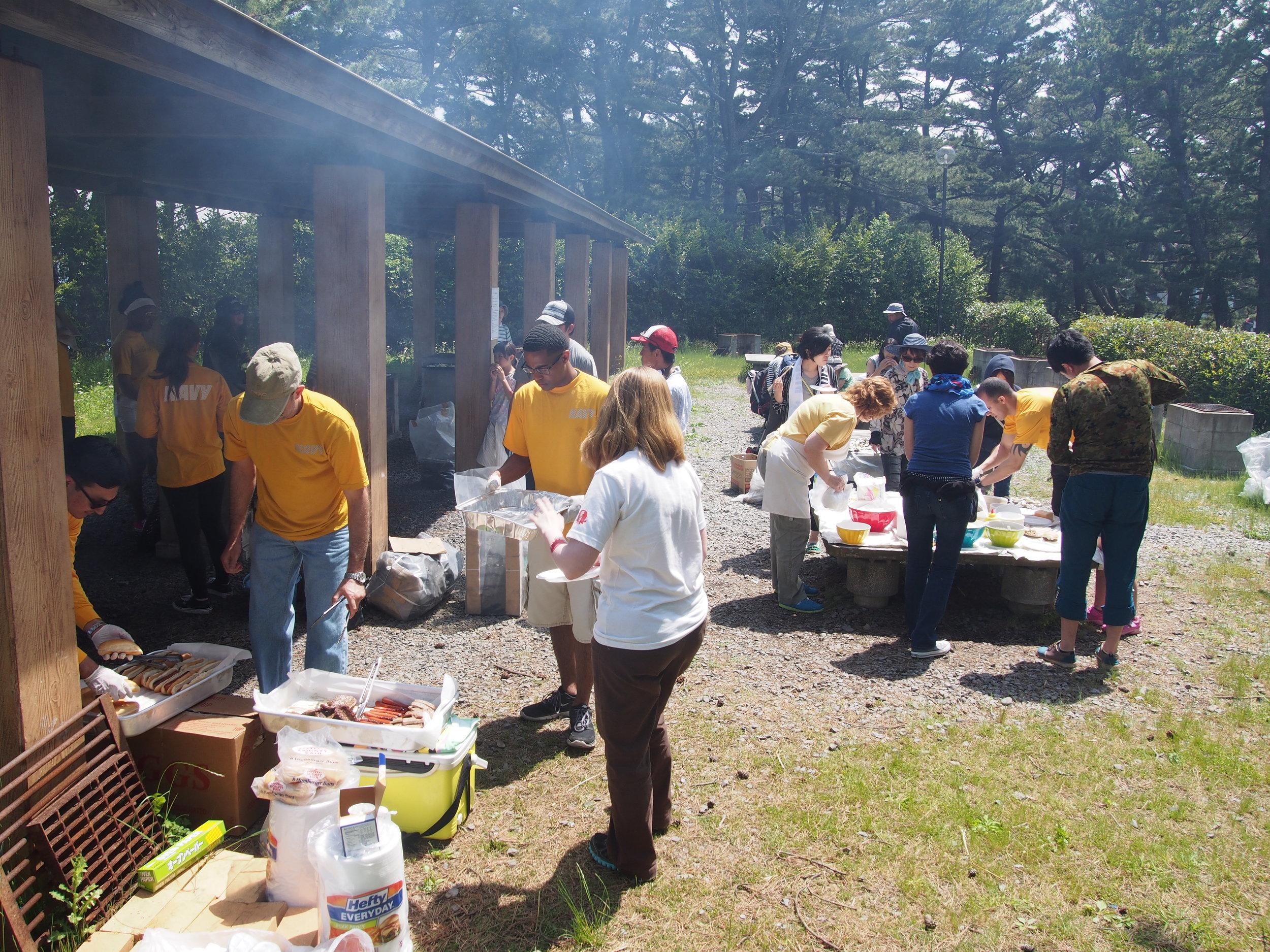 BBQ preparations underway by volunteers.