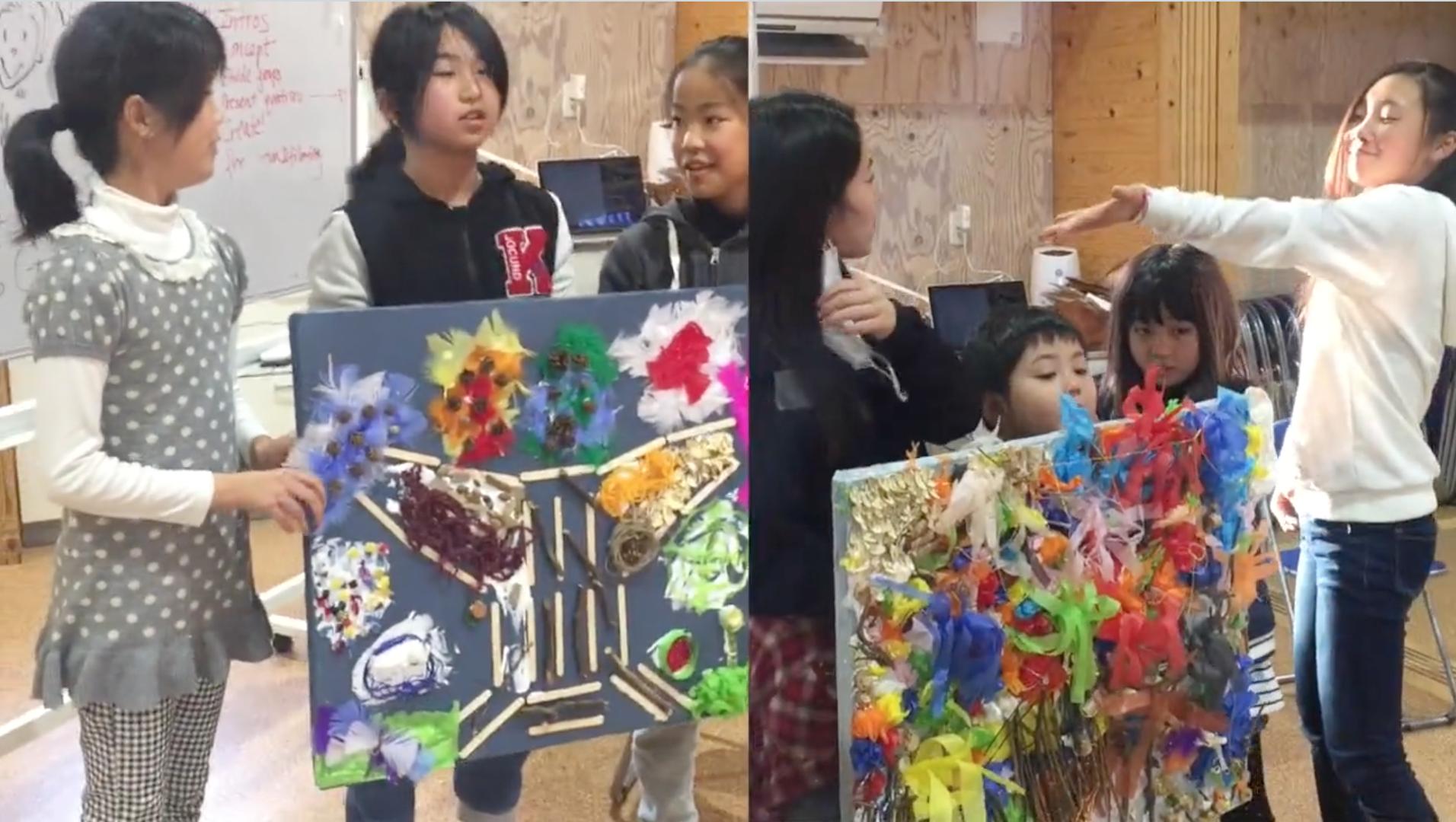 Children at the workshop presenting their art works.