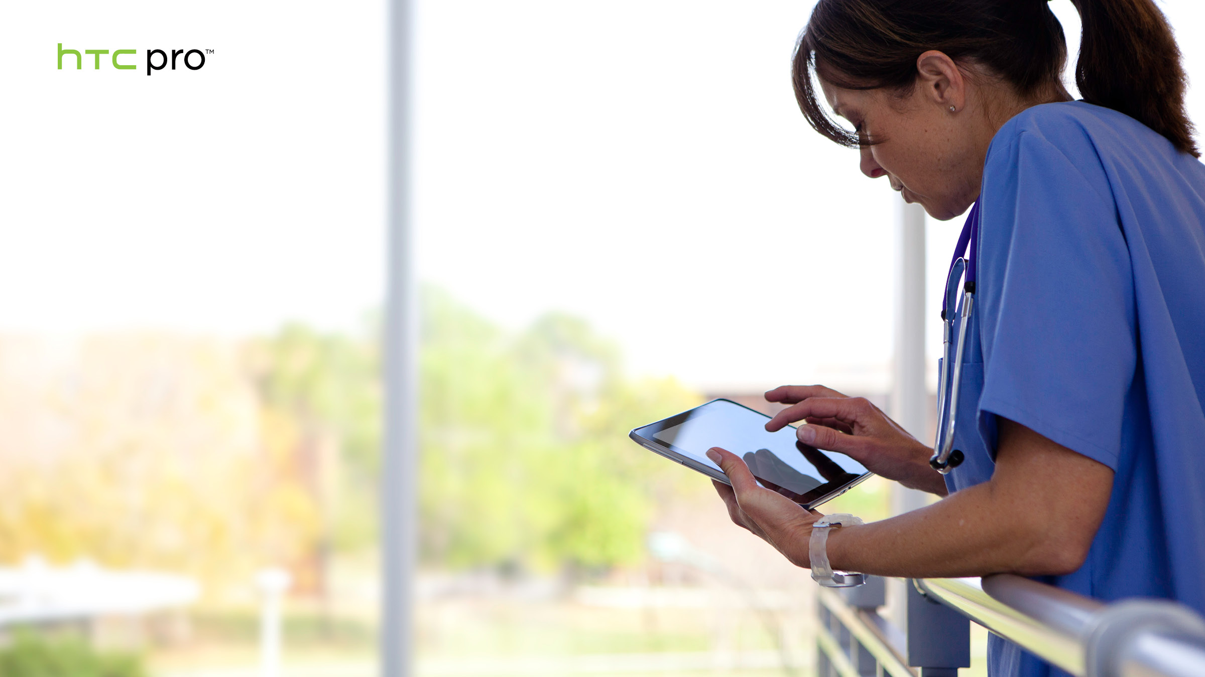 Woman using HTC Pro Tablet