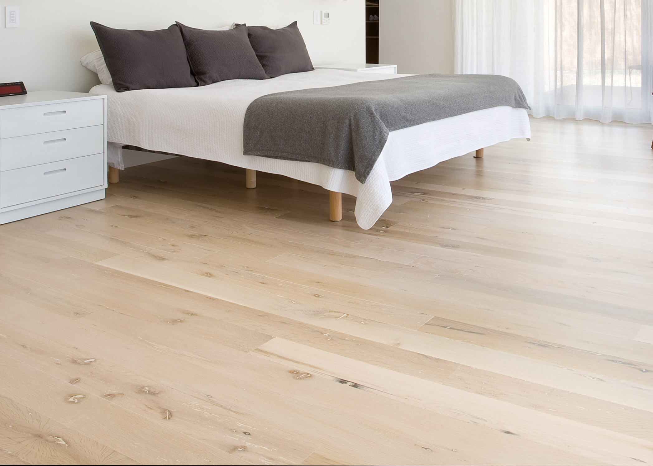 """The newest craze is white oak - this more uniformed but still custom look is coming in fast. It is lighter, it comes in both machine sewn or rough sewn so you can control the """"rustic-ness"""" of it, can be stained or just clear coated, and tighter gaps and even heights make it easier to clean."""
