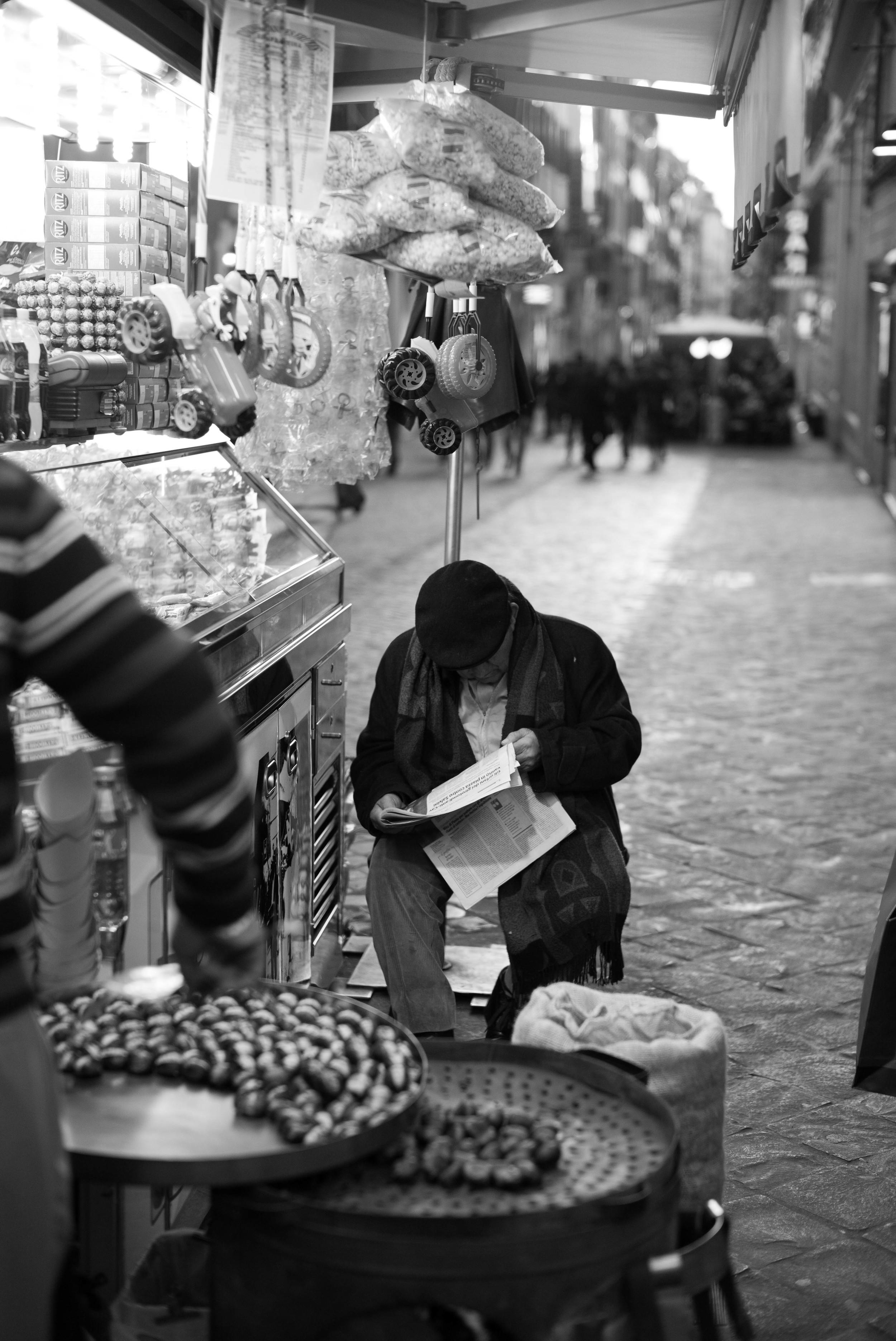 Vendor Reading Paper B&W.jpg