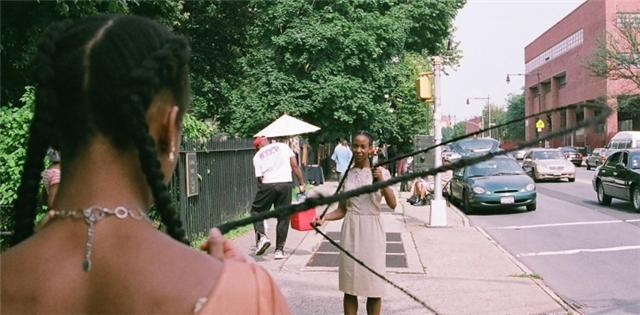 In the double version of Diva Dutch, two black women are connected to each other by their braids to form a living double dutch rope, which passersby are invited to jump into.A performance at BedStuy's Corridor Gallery is featured in this   photo essay  from NY's Daily News