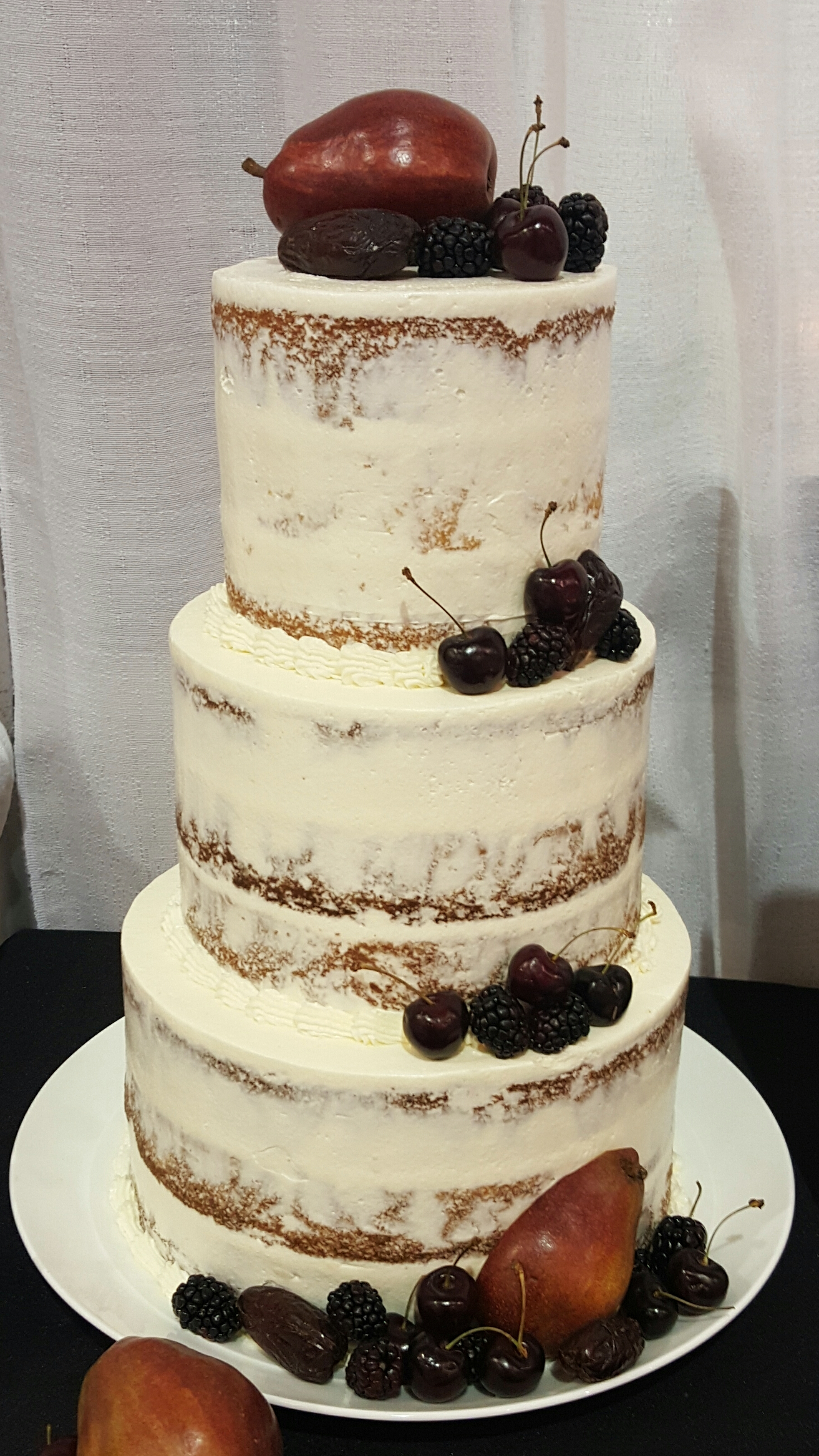 Semi-Naked cake topped with fresh cherries, blackberries, red pears and dried dates. Photo by: Sarah Blanchard Roanoke, VA