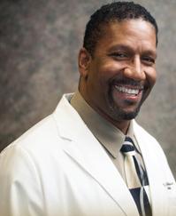 Dr, C. Neil Nicholson
