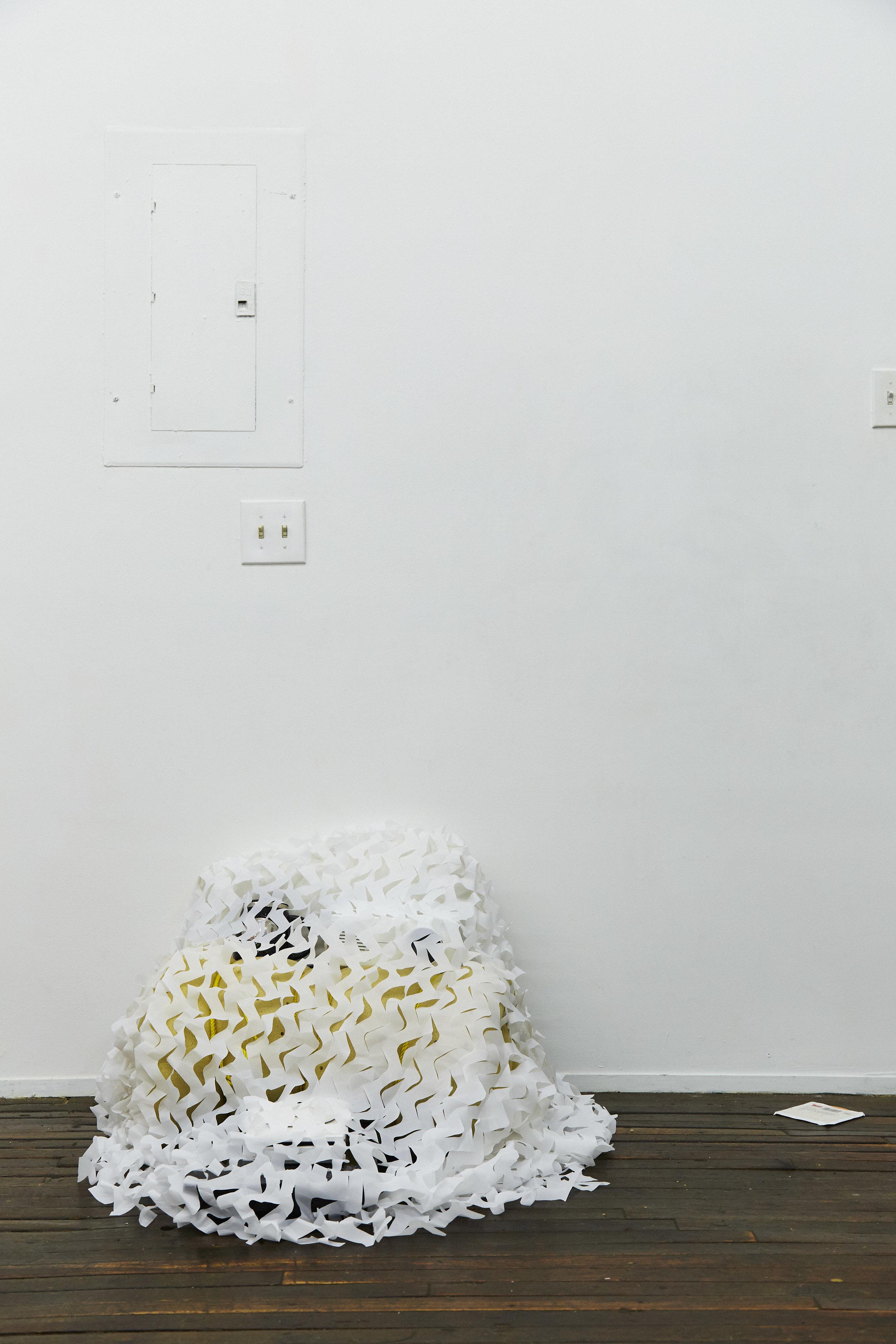 Michael Assiff,  Cache , Wii, induction burner, memory foam, pillow, engraved mug, camo net, 2017