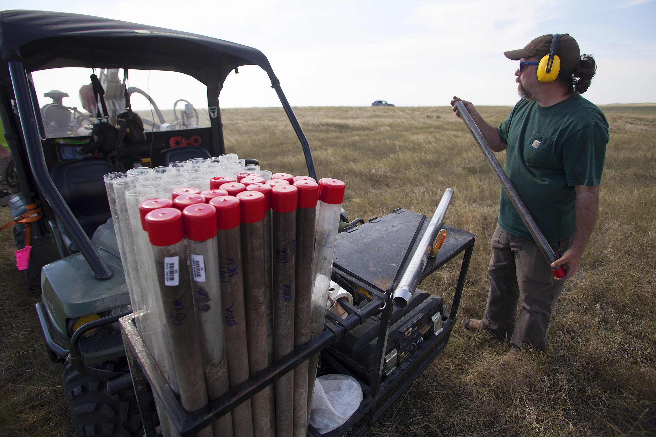 Ry Thompson, of Applied Ecological Services, places a sample of soil in a carrying tube to be lab tested at the University of Missouri for carbon and bulk density, at the 777 Bison Ranch, in Hermosa, SD. The tests will be conducted by PhD Soil Scientists and will determine the amount of carbon sequestered by tons per acre on the Ranch.