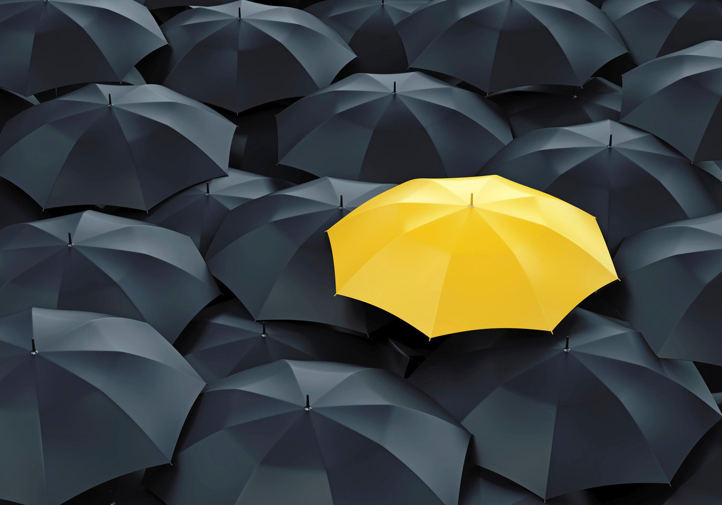 Yellow-umbrella-among-dark-ones-000068293407_Large.jpeg