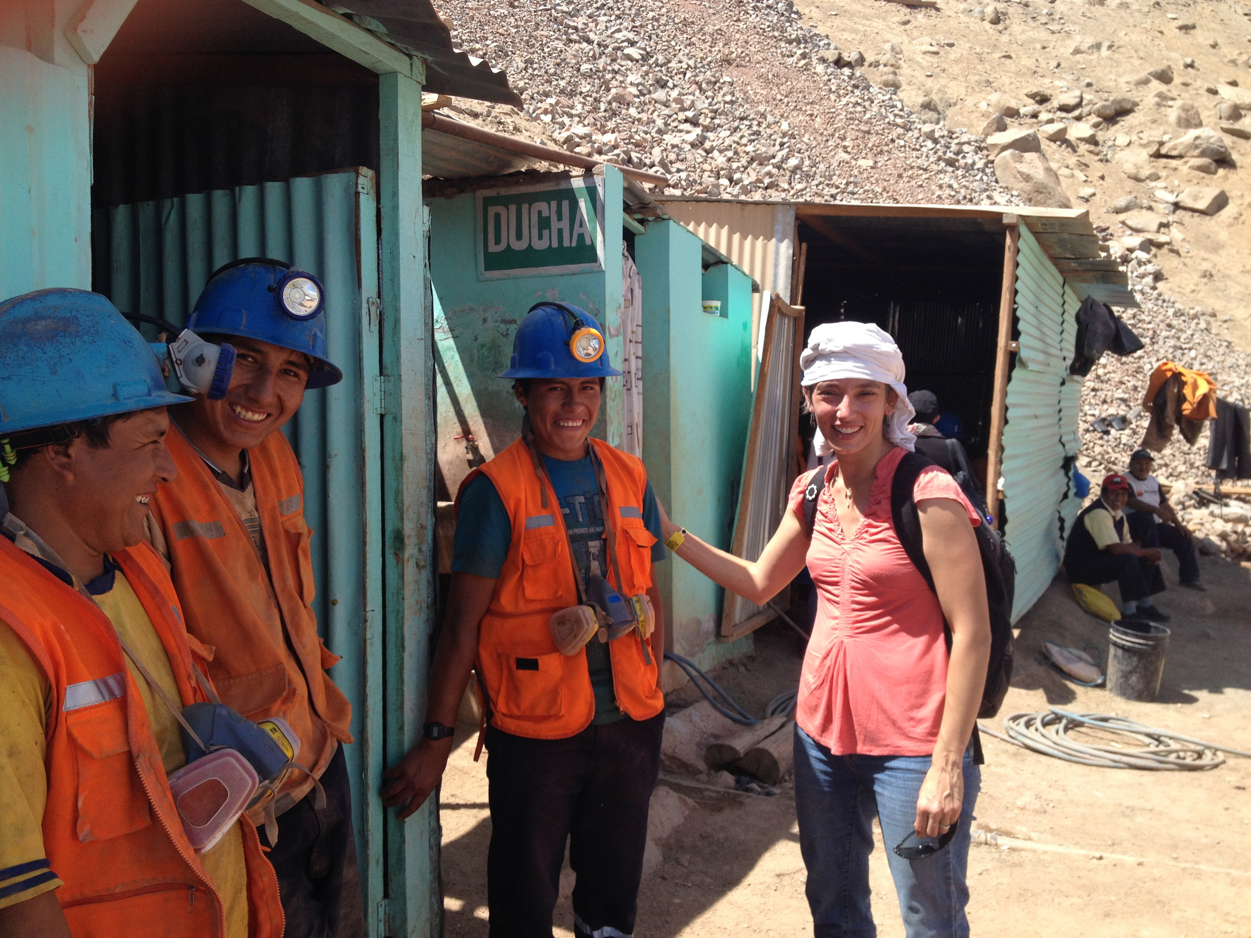 Christina T. Miller visiting with miners from AURELSA - a Fairmined certified mining organization in Relave, Peru.