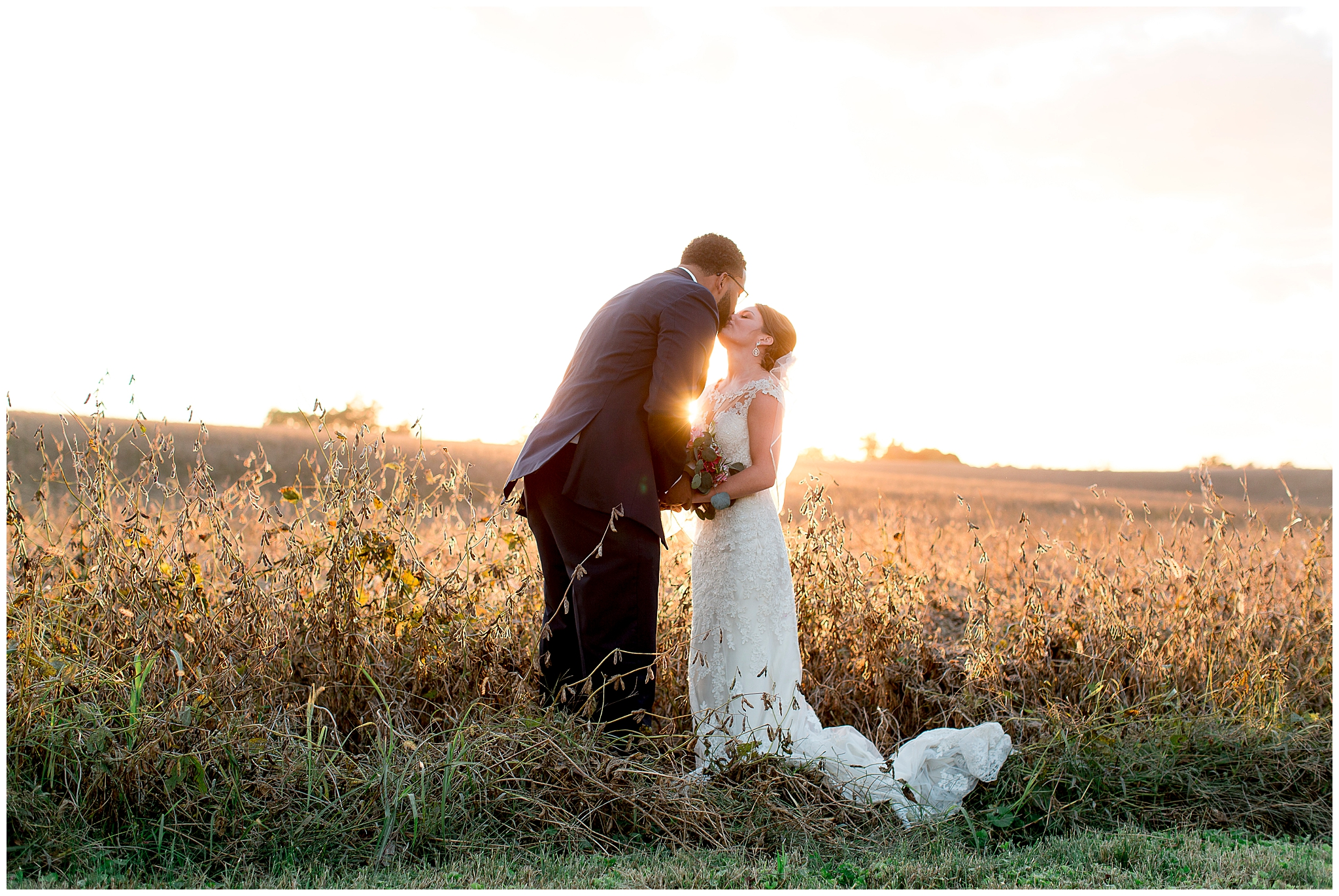 Morgan and Justin had the perfect fall, barn wedding on October 20th, 2018. Farmstead at Shawnee Trails provided a great location for both the ceremony and reception. It was a chilly day, but I don't think you can tell. The night ended in a stunning sunset that gave the bride and groom photos they will cherish for a lifetime.    Morgan started the day with mimosas and a gorgeous floral robe that complimented the florals her grandmother put together by hand! The brides wedding gown had a sweetheart neckline and sheer fabric with lace florals up to her collarbone. The dress was purchased at Meant to Be Boutique in Lexington, Ky. The bridesmaids wore maroon gowns that had sheer lace from their knee to their feet, I love the uniqueness of them!    Family means so much to Justin and Morgan and that was evident throughout the day. Morgan got embroidered handkerchiefs for all the special women in their lives and many tears were shed! She looked forward to the dance with her dad for such a long time and it was everything Morgan dreamed it would be! Justin and Morgan ended the night being celebrated out by all their loved ones.
