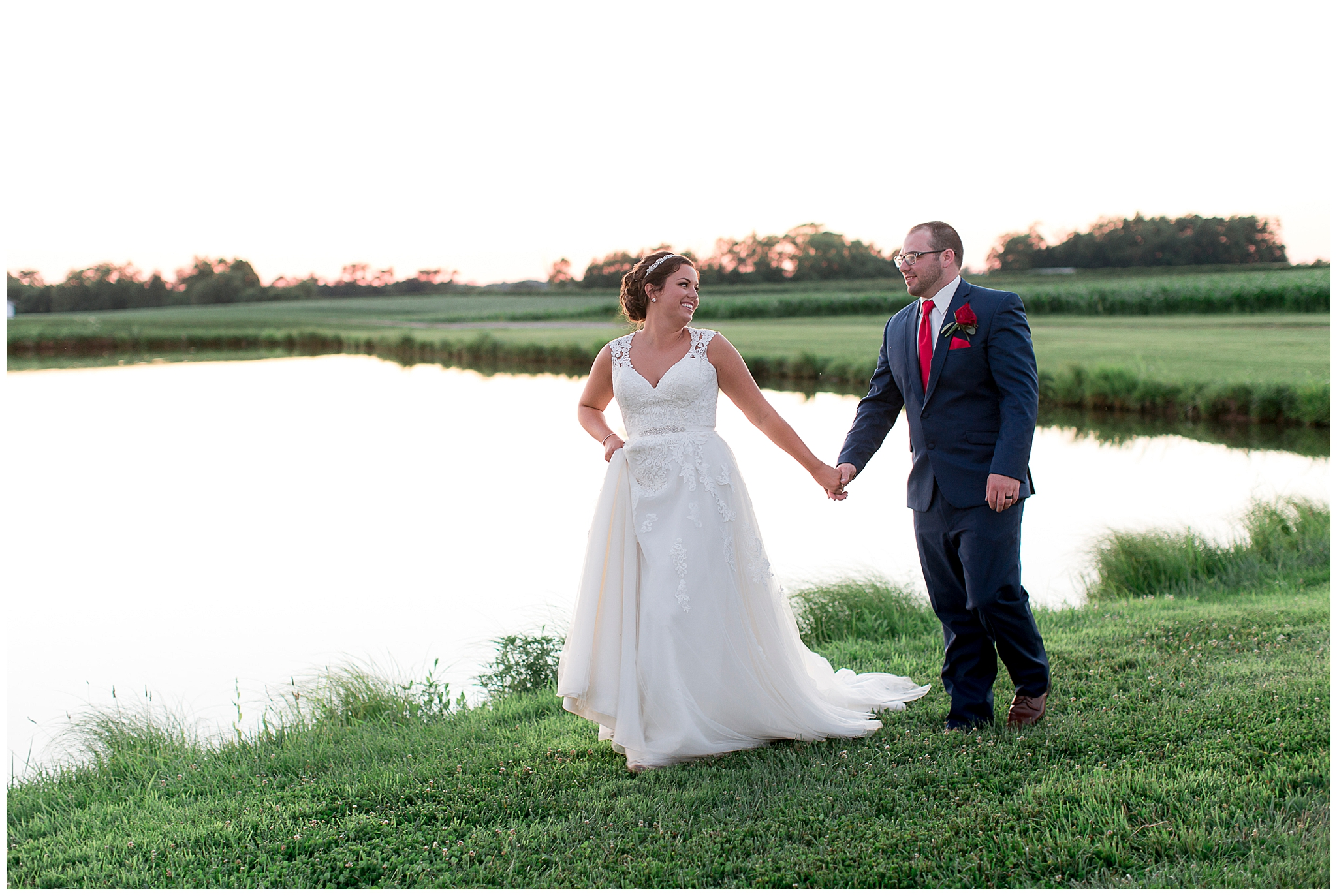 When I said I was finished blogging all of my 2018 weddings I wasn't telling the full truth. I was holding this one for the 4th of July because this wedding took place during 4th of July weekend last year. Wendy and John got married on July 7, 2018 at Gallrein Farms in Shelbyville, Ky. This wedding was full of red, white and blue from the grooms socks, to the red bridesmaid dresses and navy groomsmen suits. The day ended with a beautiful sunset and pictures by the water. Wendy's dad even brought down his 69 Camero Z28 to snap a few pictures with. Everything about this day was exactly the way Wendy and John wanted it and it was perfect. Happy 4th of July everyone, I hope you all enjoy this wedding :)