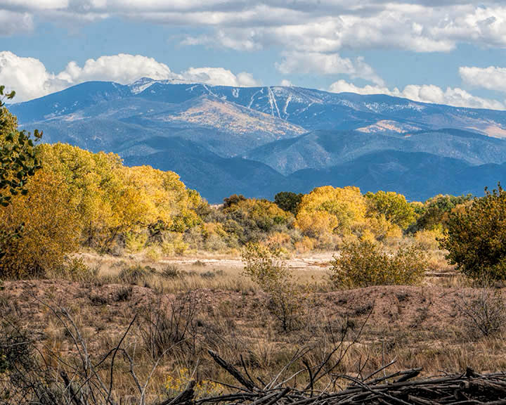 View of the Santa Fe Ski Basin from the Pojoaque River Valley. (Photo Copyright Karen Waters.)