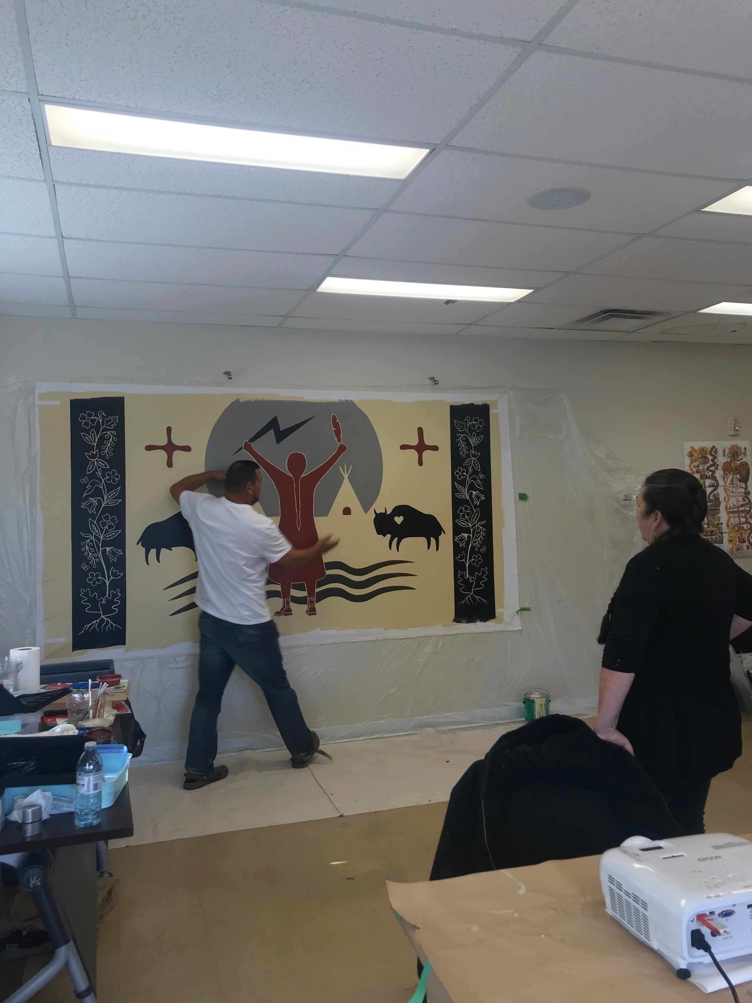Isaac and Christi working on the mural.