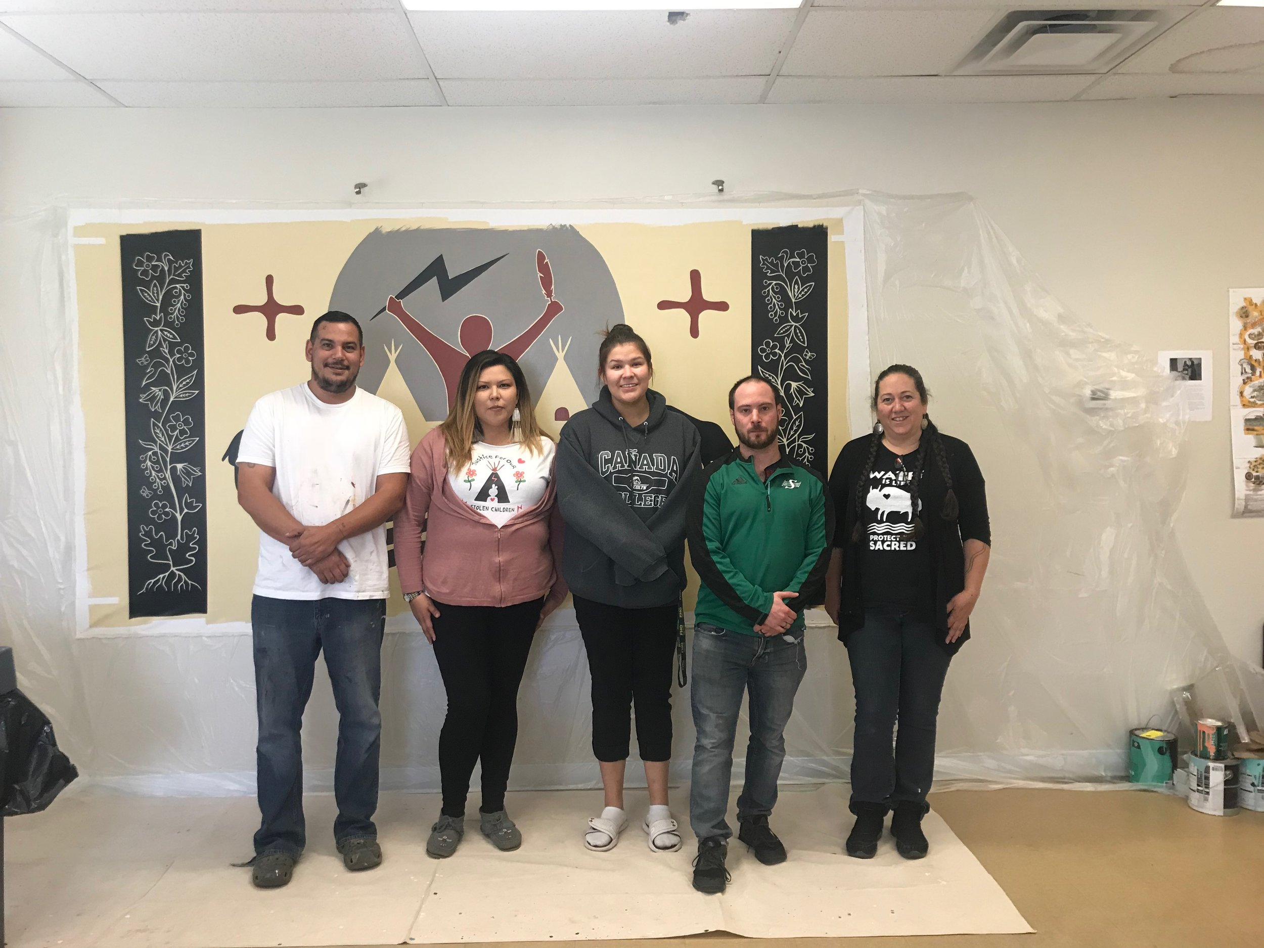 Morning Star Lodge Staff with Isaac Murdoch, Christi Belcourt, and the All Nations Hope mural.