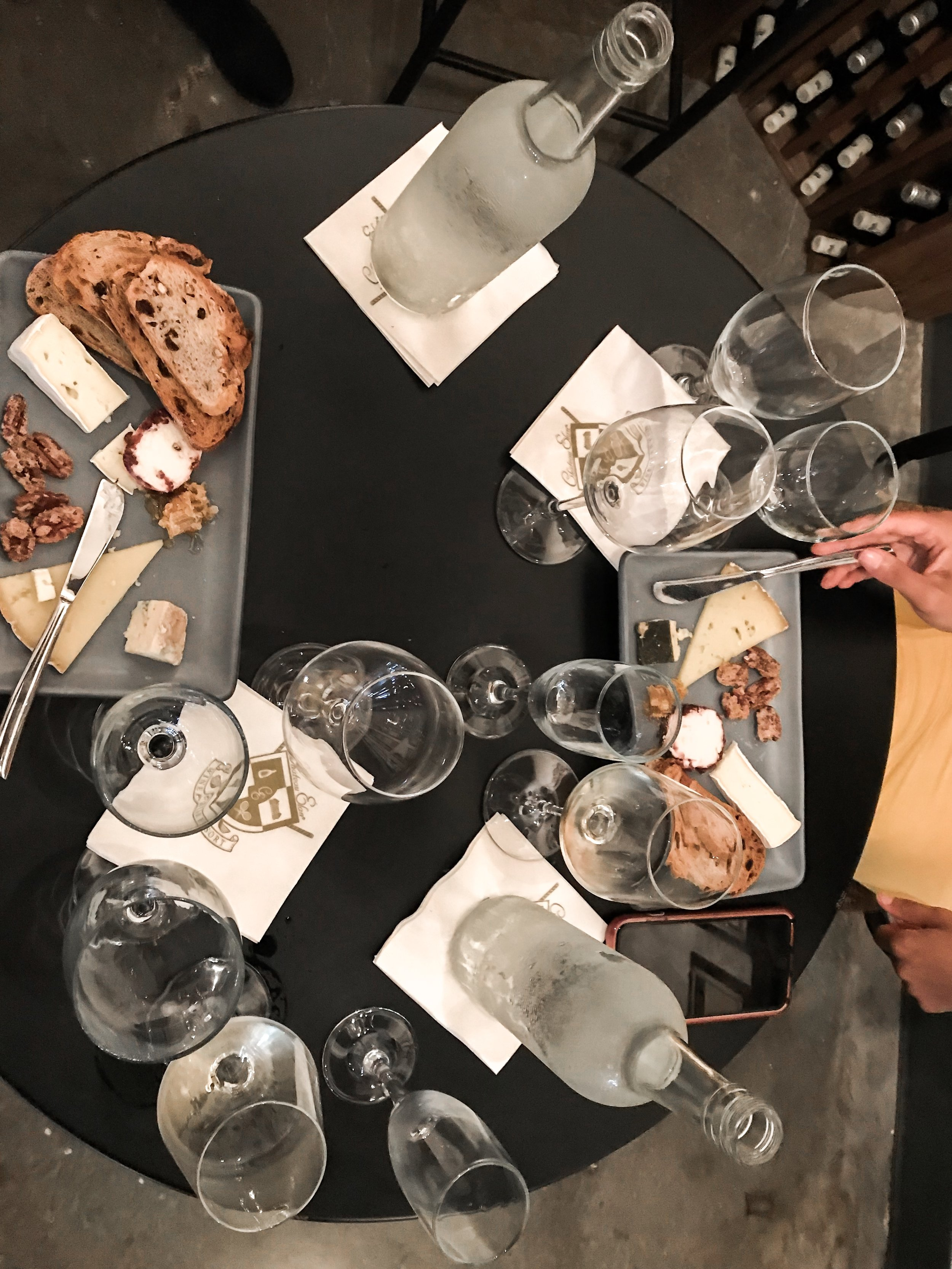 Pairing the wine with different cheeses and other small bites.