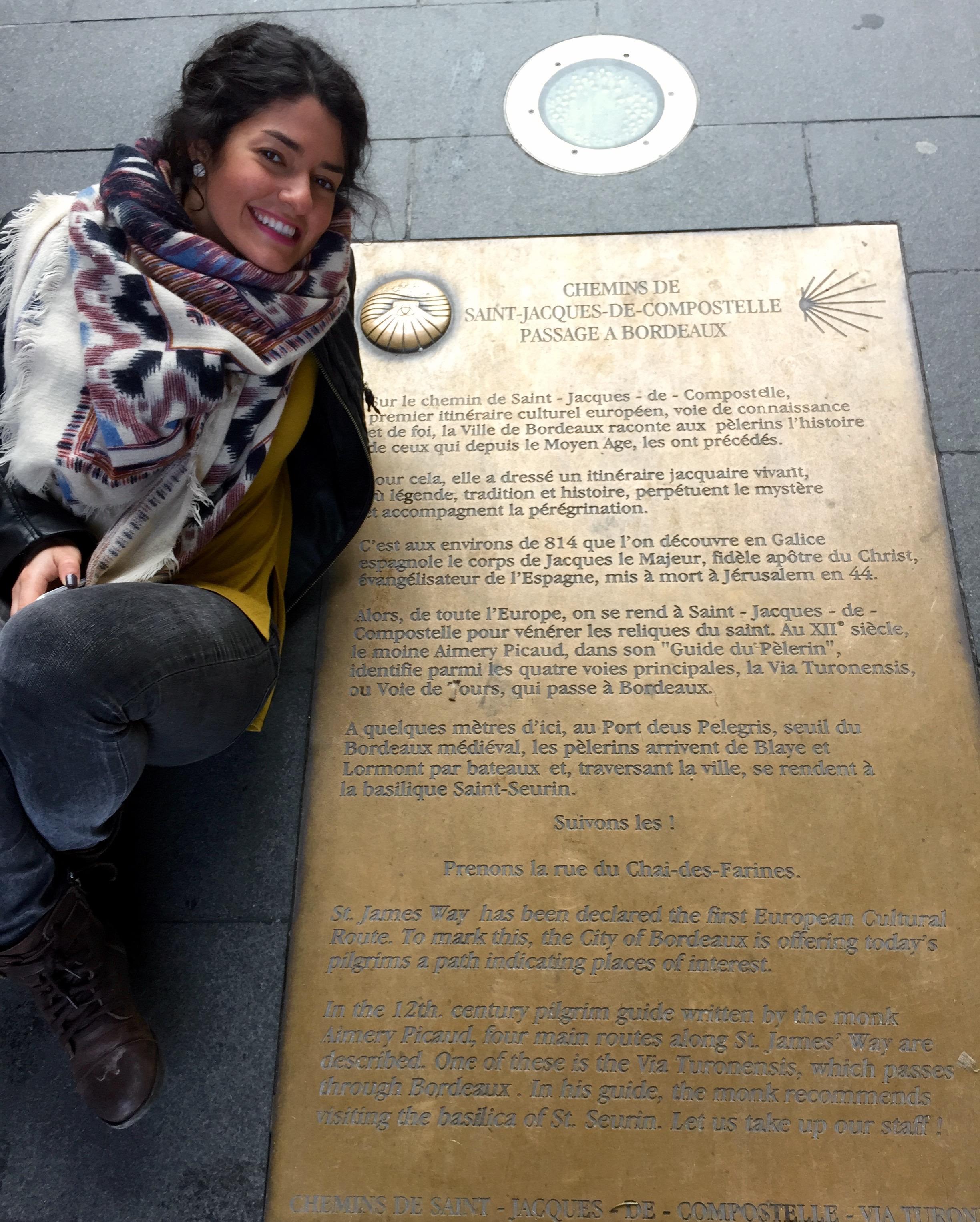 Christine with the sign for the Camino to Santiago de Compostela.