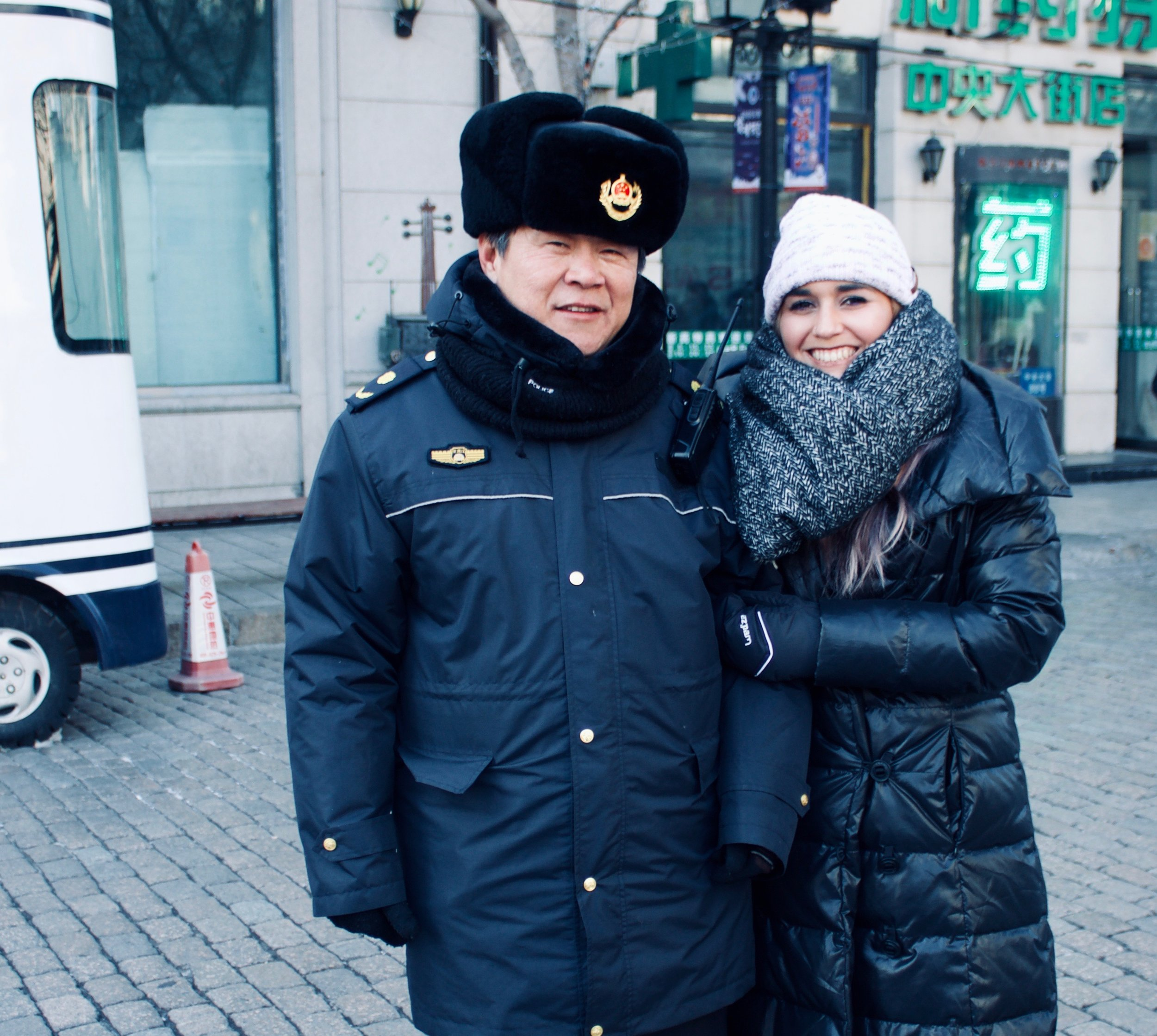 I was jealous so of course I wanted a picture with the Chinese police officer with the Russian hat.
