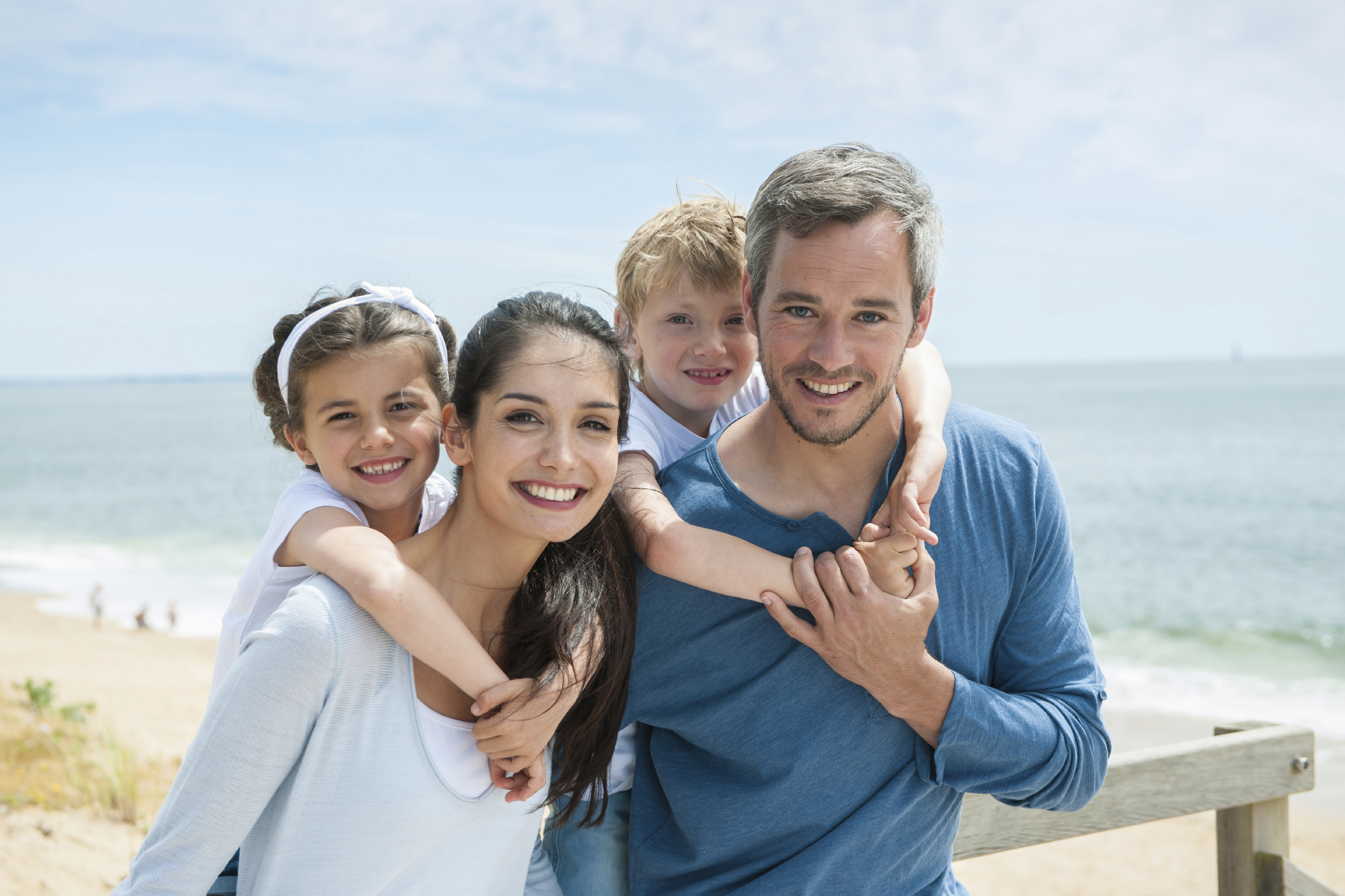 smiling-family-on-the-beach.jpg