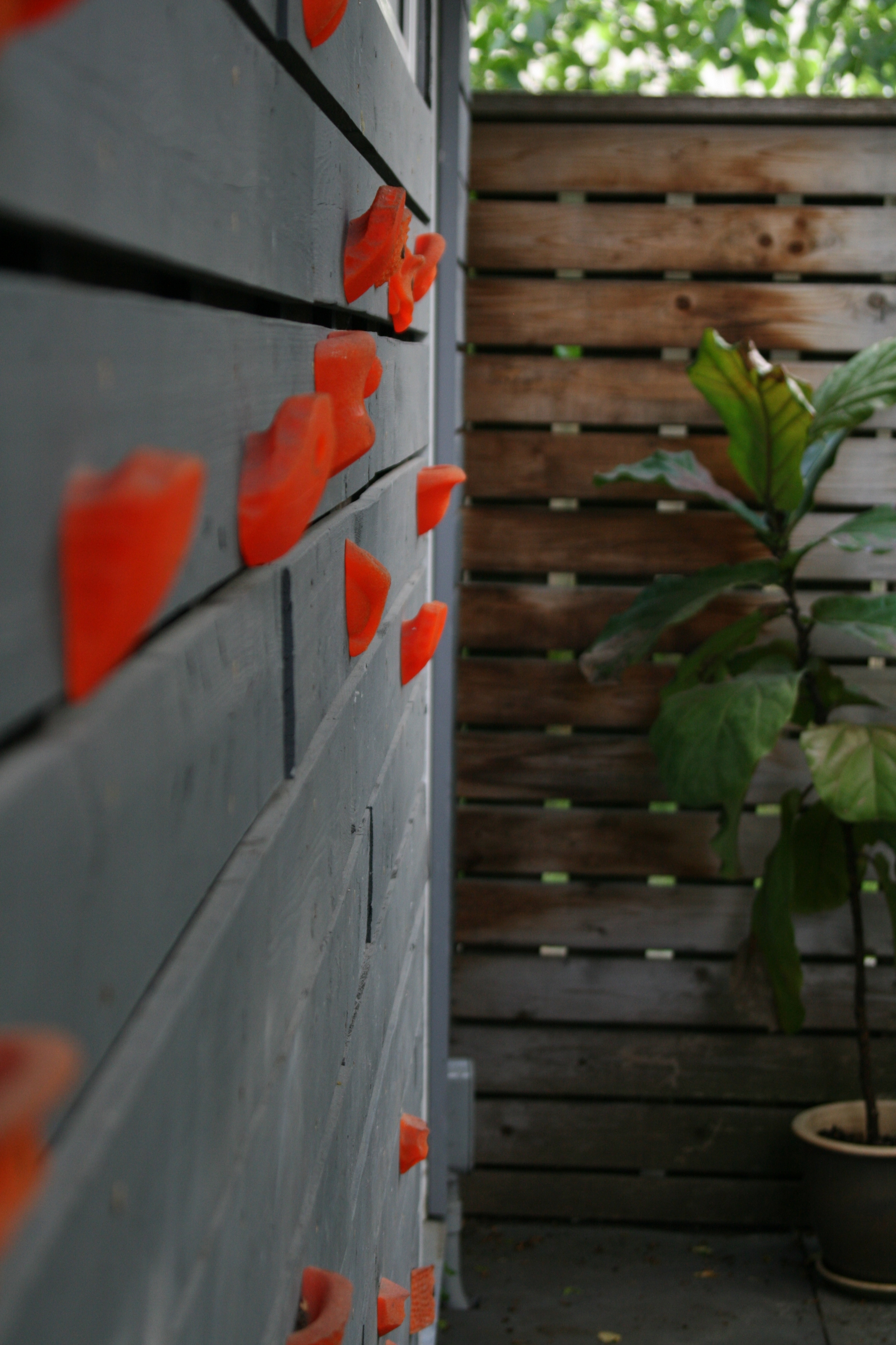 Garage wall re-clad with old fence boards.