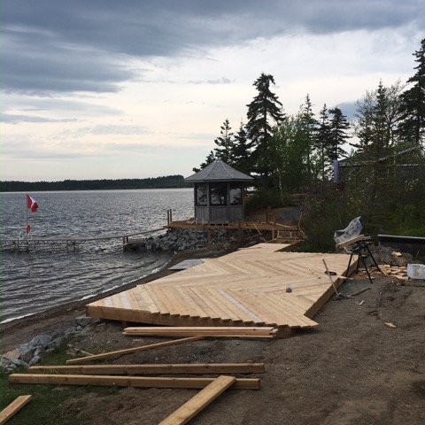 The 12'x24' common deck structure with herringbone cedar decking pattern- in progress.